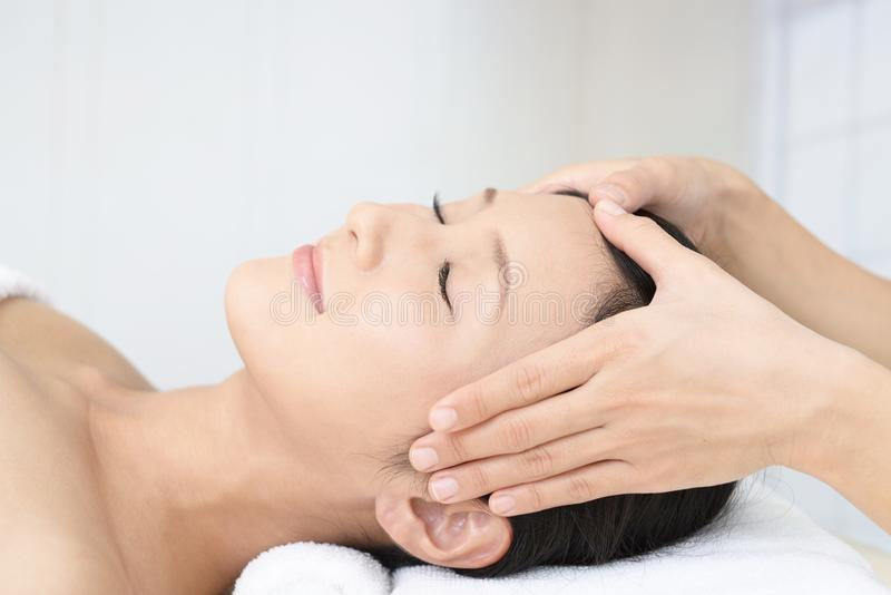 Beautiful young woman receiving facial massage stock photography