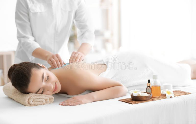 Beautiful young woman receiving scrub massage royalty free stock images
