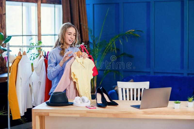 Beautiful young woman recording video about new trend in the clothes. stock photography
