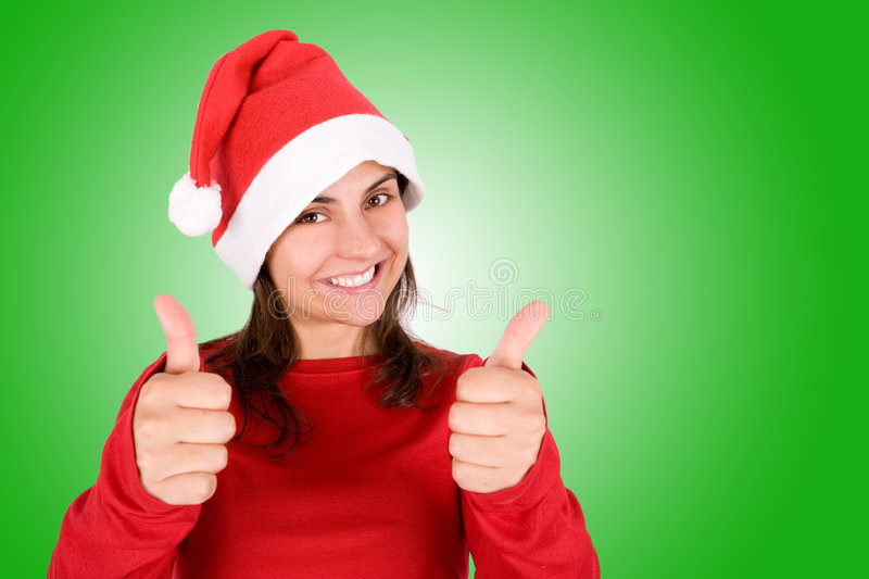 Beautiful young woman with red christmas hat
