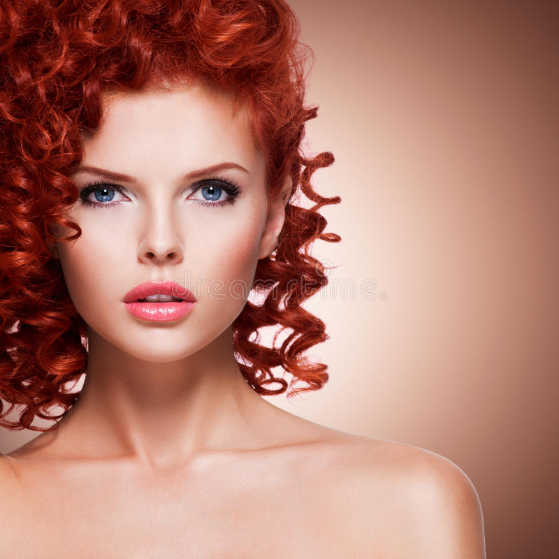 Beautiful young woman with red curly hair. royalty free stock photos