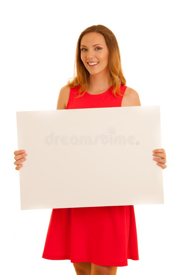 Beautiful young woman in red dress holding white blank banner for additional text or graphics isolated over white stock photos