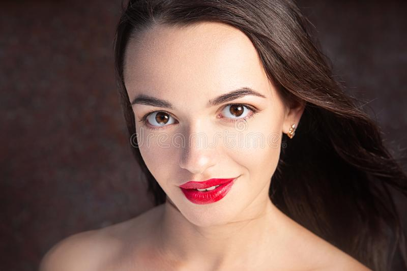 Beautiful young woman with red lipstick, closeup portrait. Fashion beauty spa, cosmetology, cosmetics concept royalty free stock images
