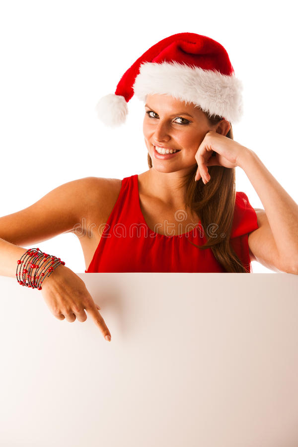 Beautiful young woman in red santa claus dress pointing to red b stock photos