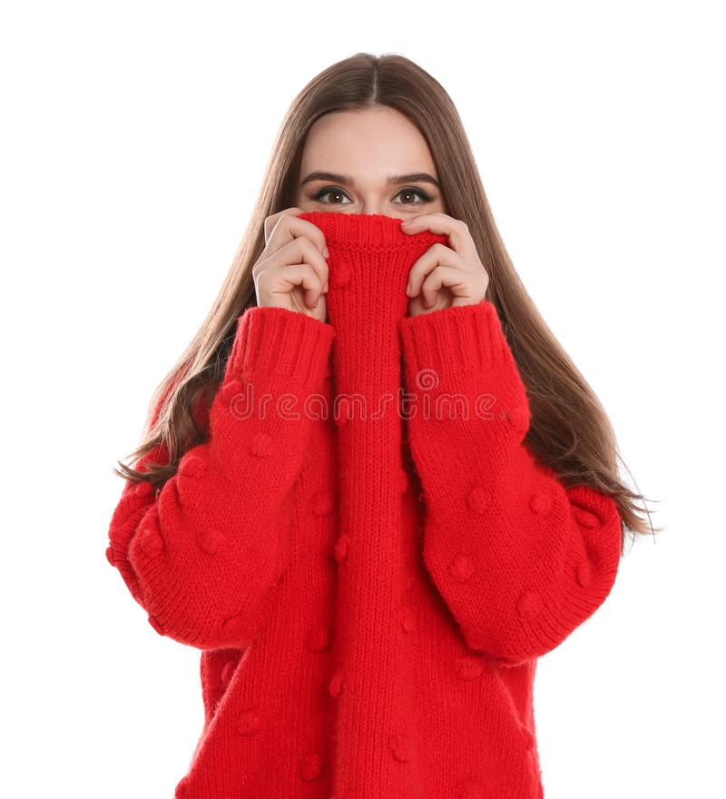 Beautiful young woman in red sweater on white. Winter season royalty free stock photography