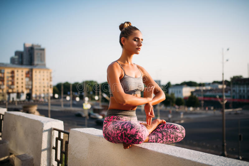 Beautiful young woman relax in yoga pose royalty free stock photo