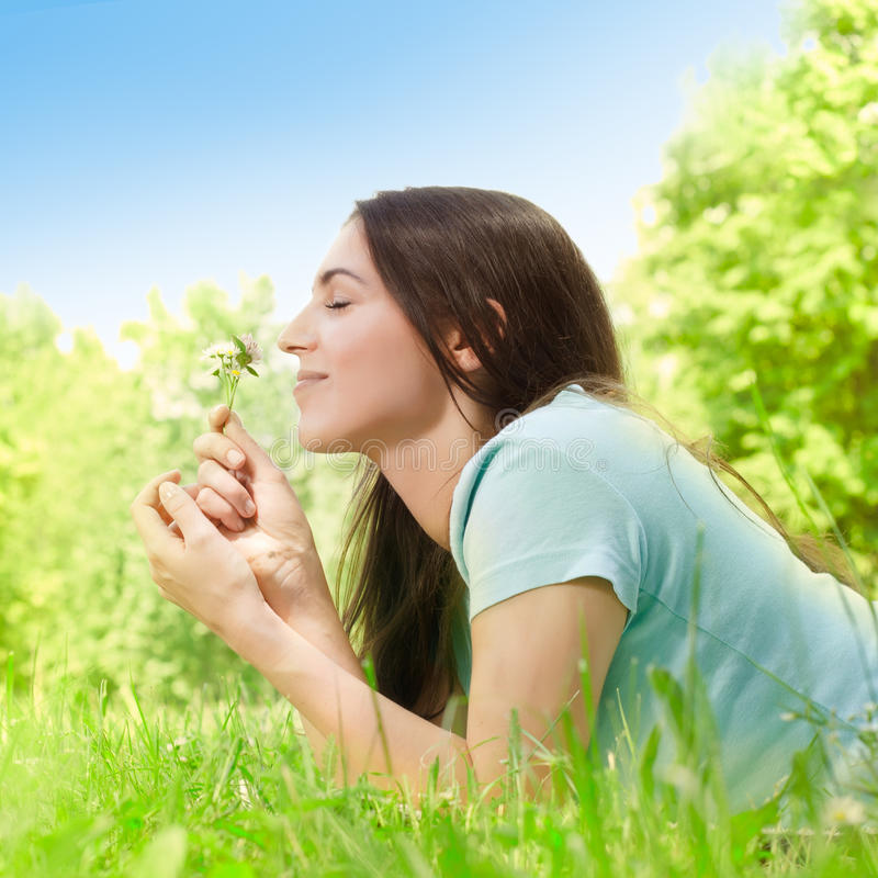Beautiful young woman relaxing royalty free stock photography