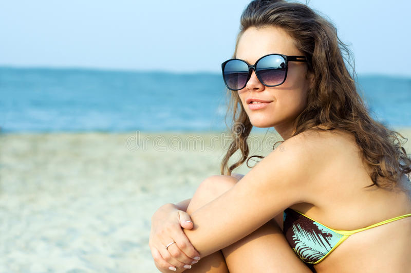 Beautiful Young Woman Relaxing On The Beach Stock Photography
