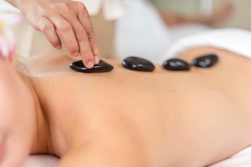 Beautiful young woman relaxing with hand massage at beauty spa. Body massage. Closed up of young beautiful woman getting spa royalty free stock photo