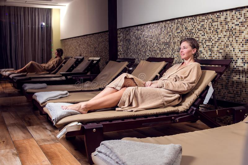 Beautiful young woman relaxing and enjoing her time in the spa salon stock photography