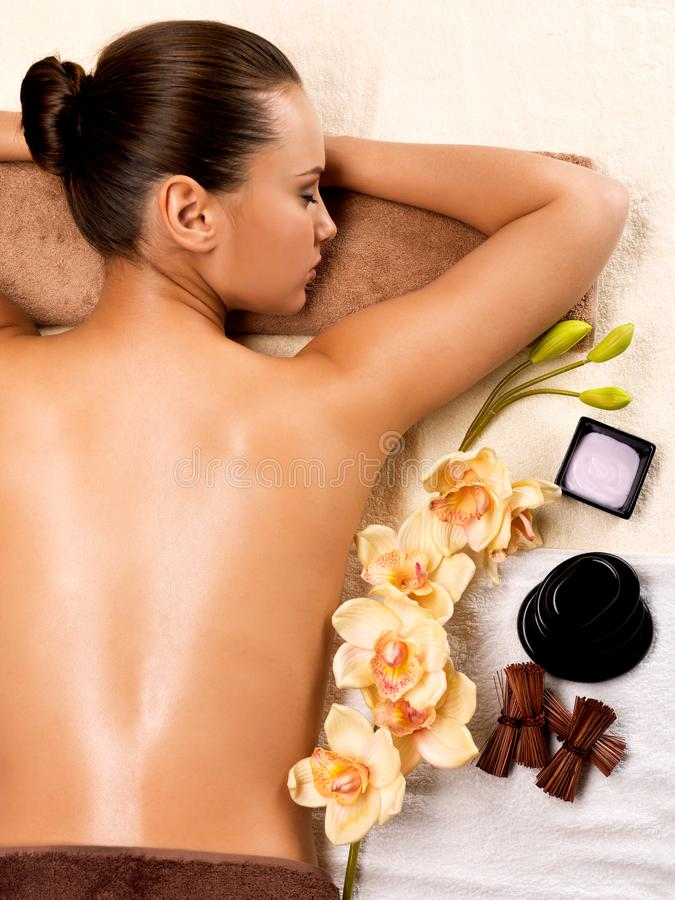 Beautiful young woman relaxing in the spa salon. Beauty treatment concept stock photography