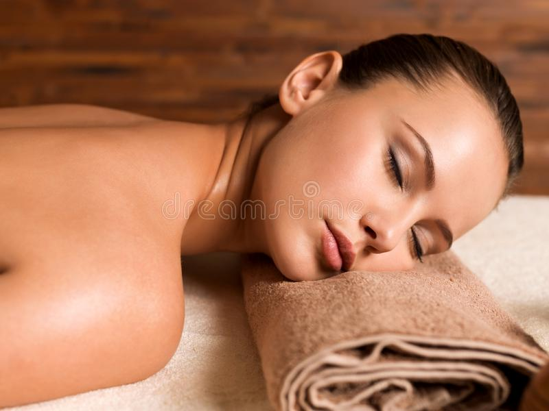 Beautiful young woman relaxing in the spa salon. Beauty treatment concept stock photo