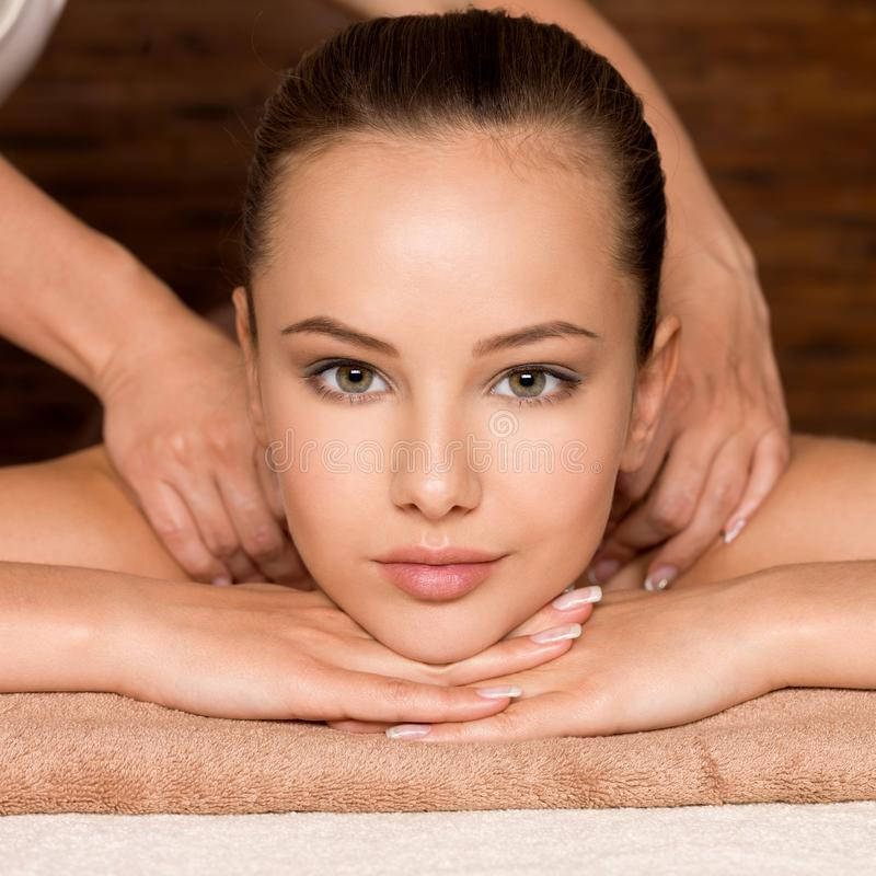 Beautiful young woman relaxing in the spa salon. Closeup portrait of beautiful young woman relaxing in the spa salon. Beauty treatment concept royalty free stock photos
