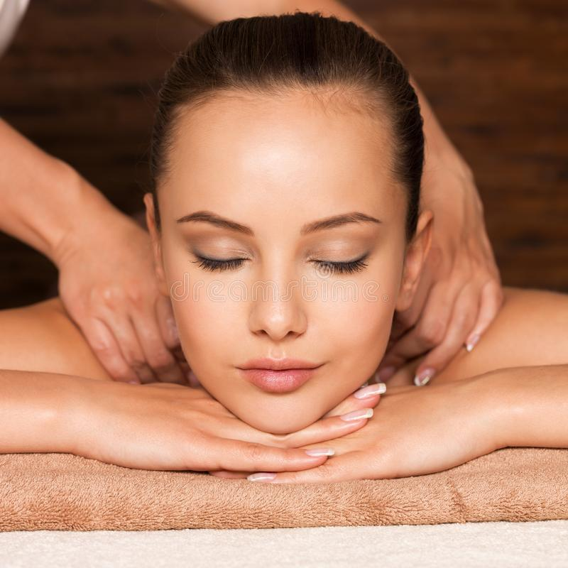 Beautiful young woman relaxing in the spa salon. Closeup portrait of beautiful young woman with closed eyes relaxing in the spa salon. Beauty treatment concept stock image