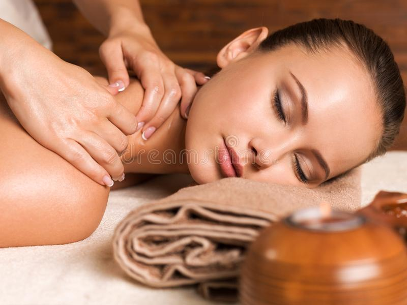 Beautiful young woman relaxing in the spa salon. Closeup portrait of beautiful young woman with closed eyes relaxing in the spa salon. Beauty treatment concept stock images