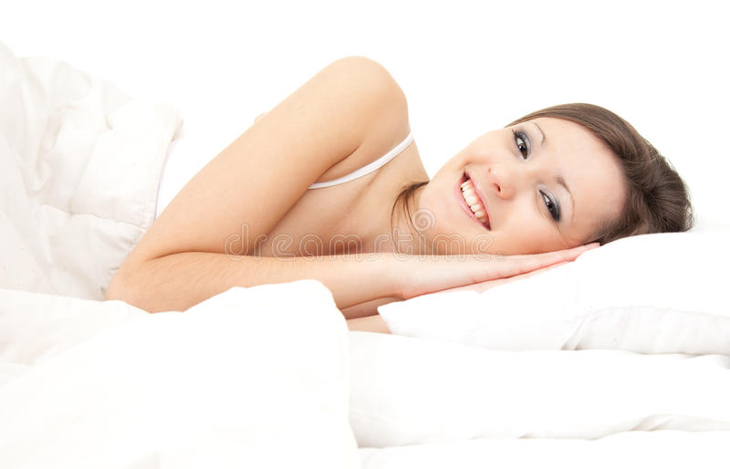 Beautiful Young Woman Relaxing In White Bedding Royalty Free Stock Images