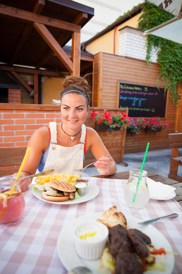 Beautiful young woman in restaurant royalty free stock images