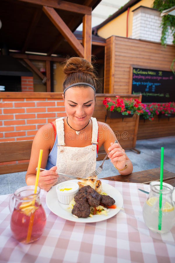 Beautiful young woman in restaurant stock photo