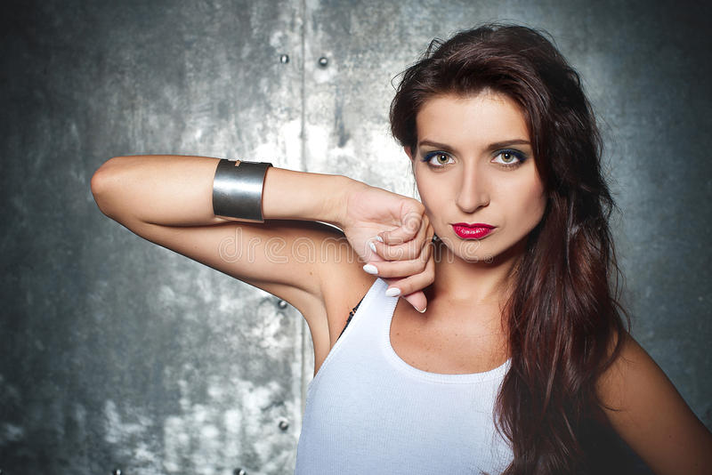 Beautiful young woman in a rock style royalty free stock photography