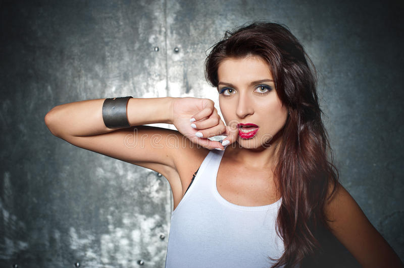 Beautiful young woman in a rock style royalty free stock image