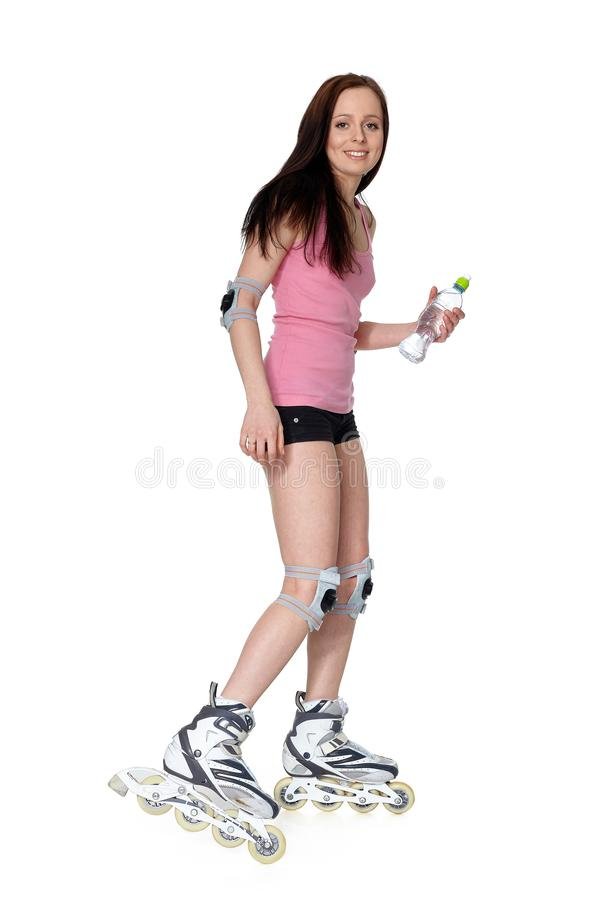 The beautiful young woman in rollerskates royalty free stock photos