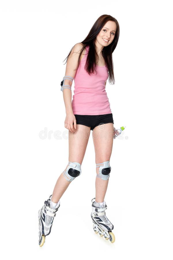 The beautiful young woman in rollerskates stock photography