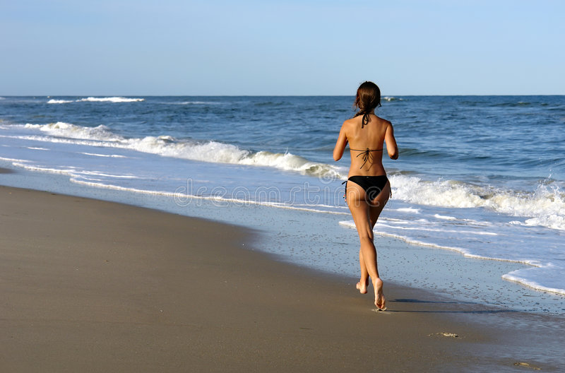 Download Beautiful Young Woman Running On The Beach Stock Photo - Image: 9036442