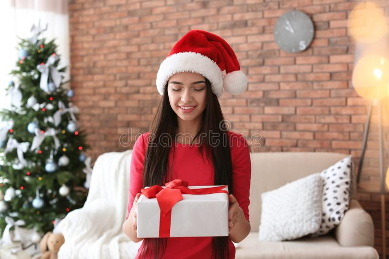 Beautiful young woman in Santa hat with gift box stock photos