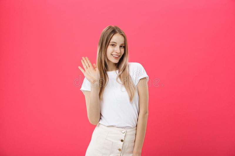 Beautiful young woman say hello isolated on pink background stock images