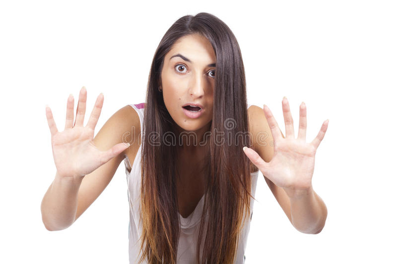 Beautiful young woman scared stock photo