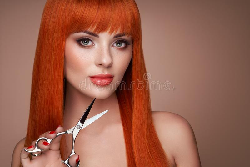 Beautiful young woman with a scissors royalty free stock photography