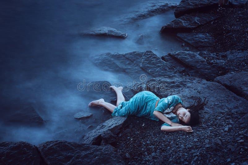 Beautiful young woman on sea stock image