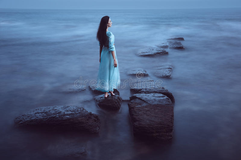 Beautiful young woman on sea stock photos
