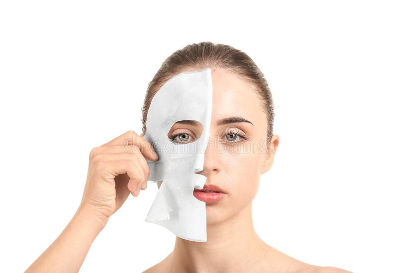 Beautiful young woman with sheet facial mask on white background royalty free stock photo