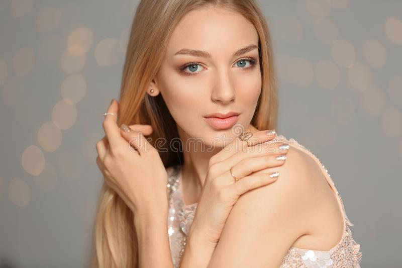 Beautiful young woman with shiny manicure. Nail polish trends royalty free stock images