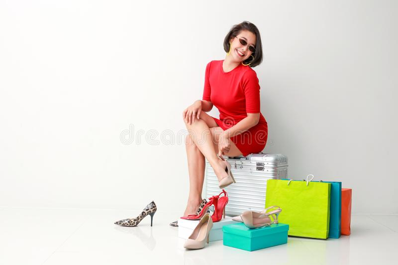 Beautiful young woman with shopping luggage and bags stock photos