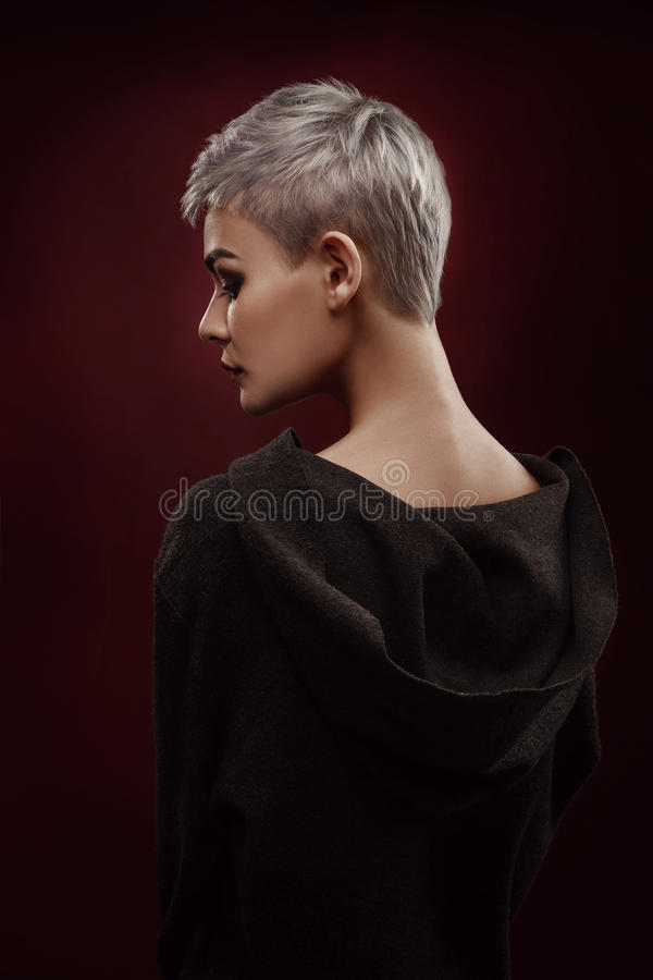 Beautiful young woman with short grey hair royalty free stock images