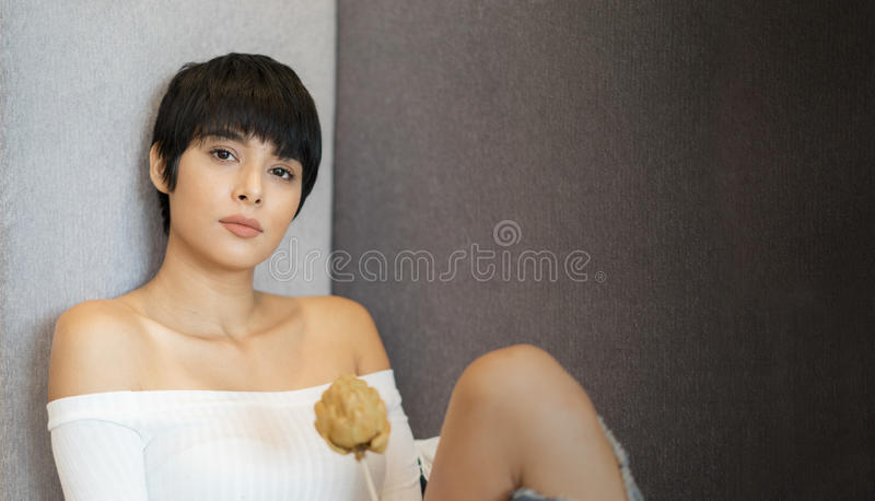 Beautiful young woman with short hair royalty free stock images
