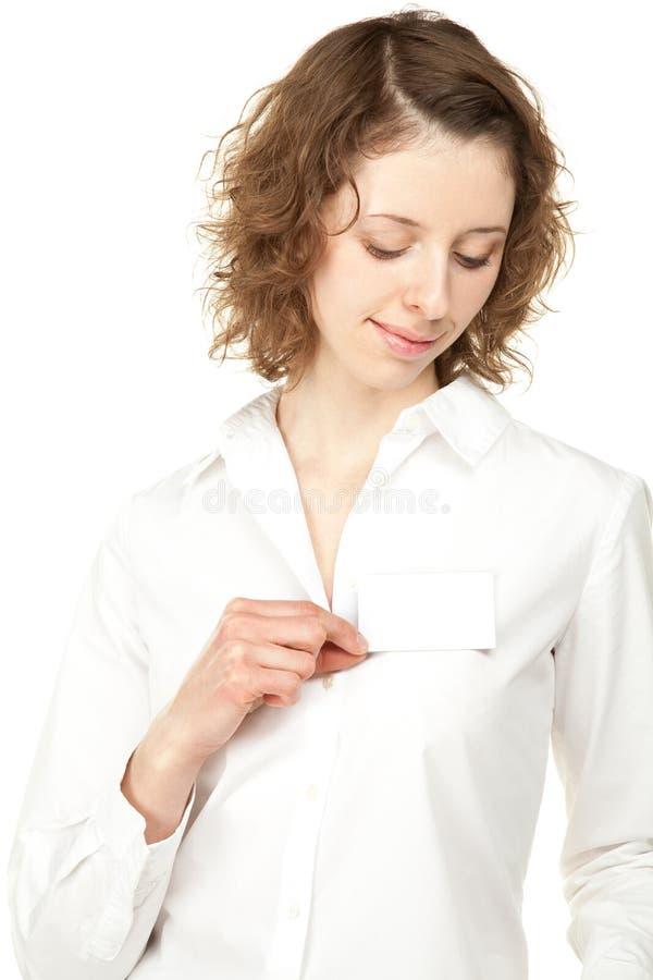 Beautiful young woman showing blank name badge