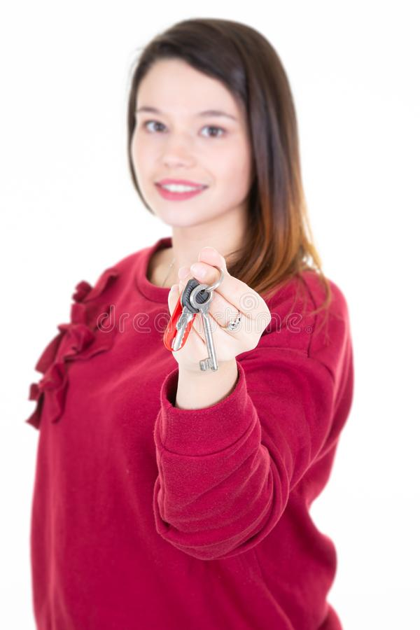Beautiful young woman showing house keys stock photos
