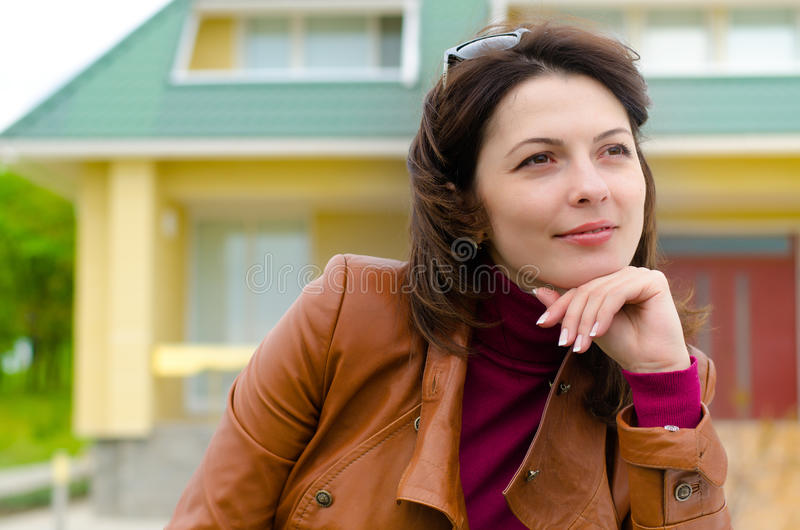 Beautiful young woman sitting daydreaming stock images