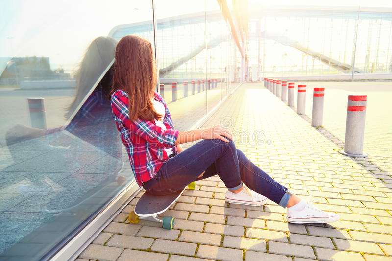 Beautiful young woman with a skateboard stock photos