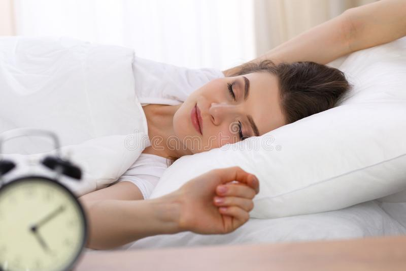 Beautiful young woman sleeping while lying in her bed. Concept of pleasant and rest reinstatement for active life royalty free stock photography
