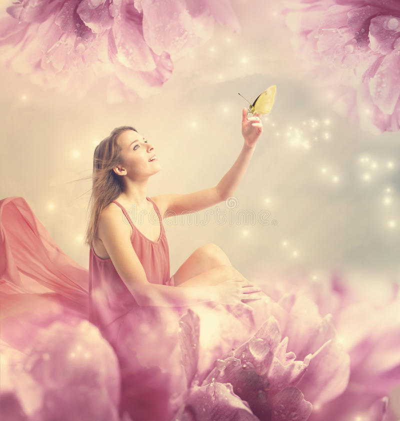 Beautiful young woman with small butterfly. Beautiful young woman with a small butterfly on peony flower stock photos