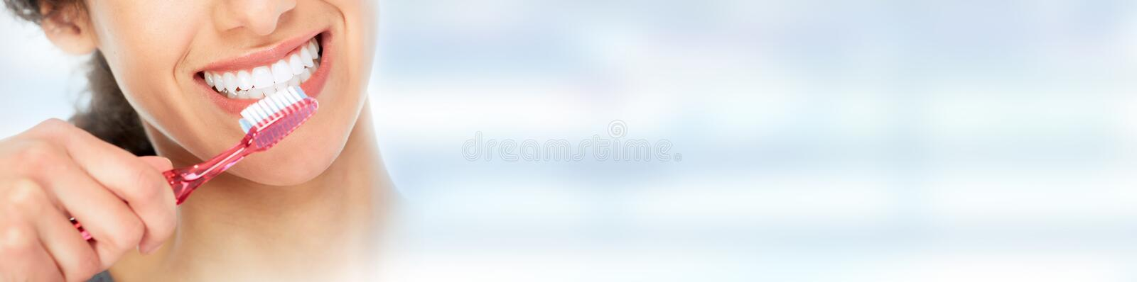 Woman with toothbrush. royalty free stock images