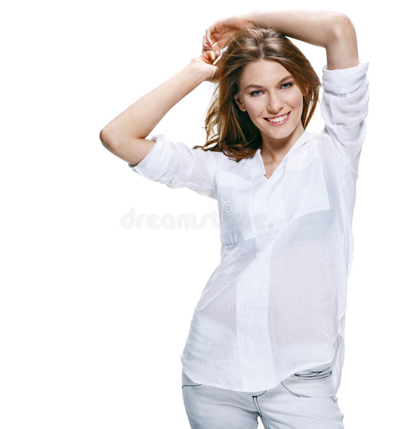 Beautiful young woman smiles to the camera isolated on white background stock image