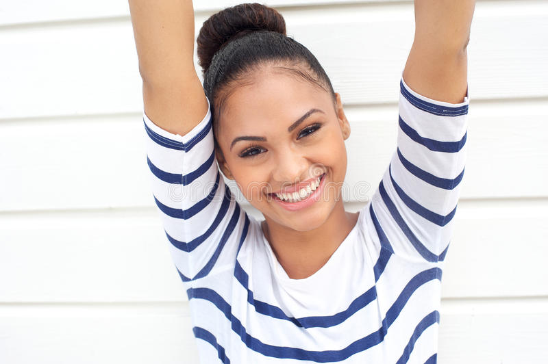 Download Beautiful Young Woman Smiling With Arms Raised Stock Image - Image: 33872533