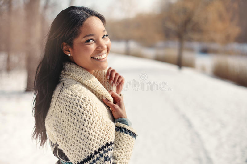 Beautiful young woman in the snow in winter royalty free stock images
