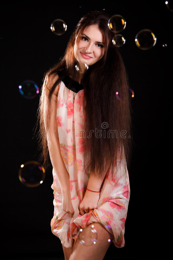 Beautiful young woman with soap bubbles royalty free stock image