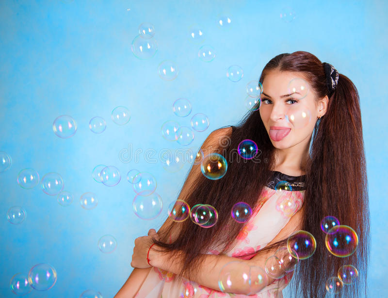 Beautiful young woman with soap bubbles stock image
